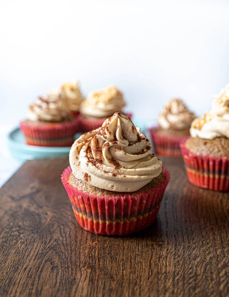 Irish cream tiramisu cupcake in front of other cupcakes