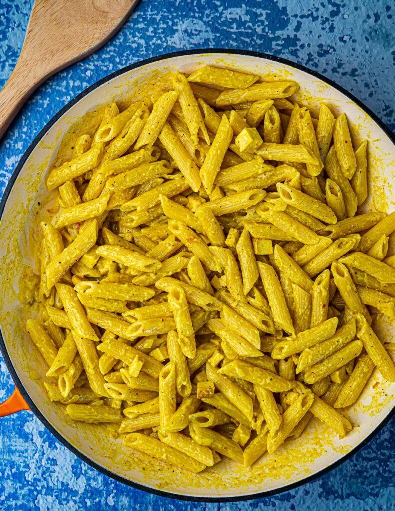 Vegan Pasta Carbonara in pan with wooden spoonWith Smoked Tofu