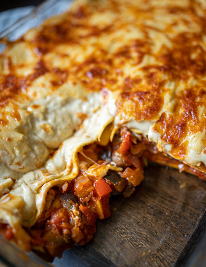 Cut out lasagne in tray showing vegetables and halloumi