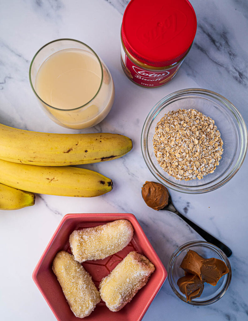 Biscoff smoothie with oats and banana ingredients, including oat milk, frozen banana, rolled oats and Biscoff spread