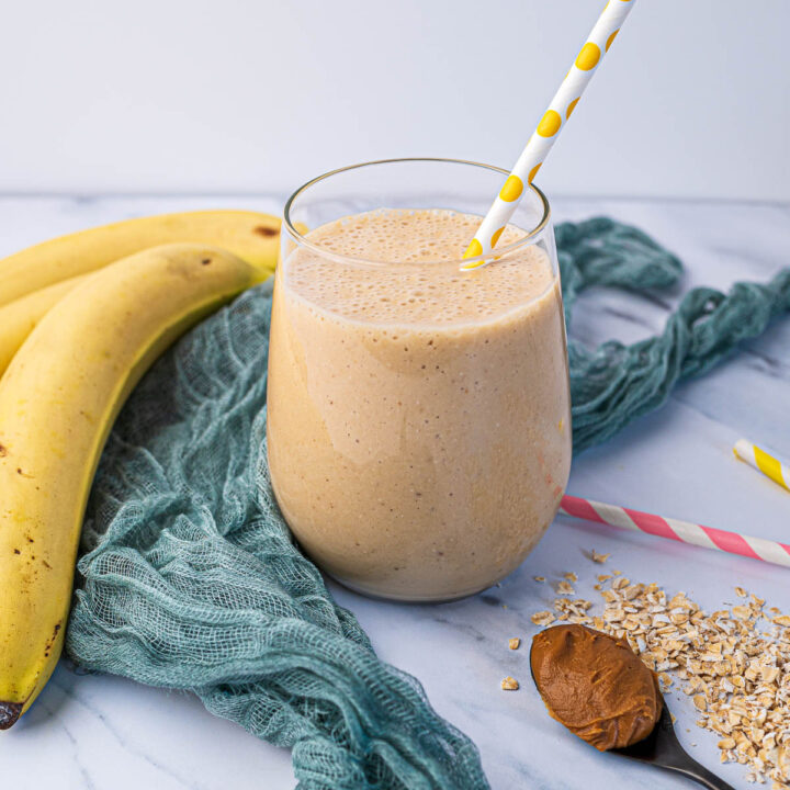 Biscoff smoothie with oats and banana in glass with yellow straw