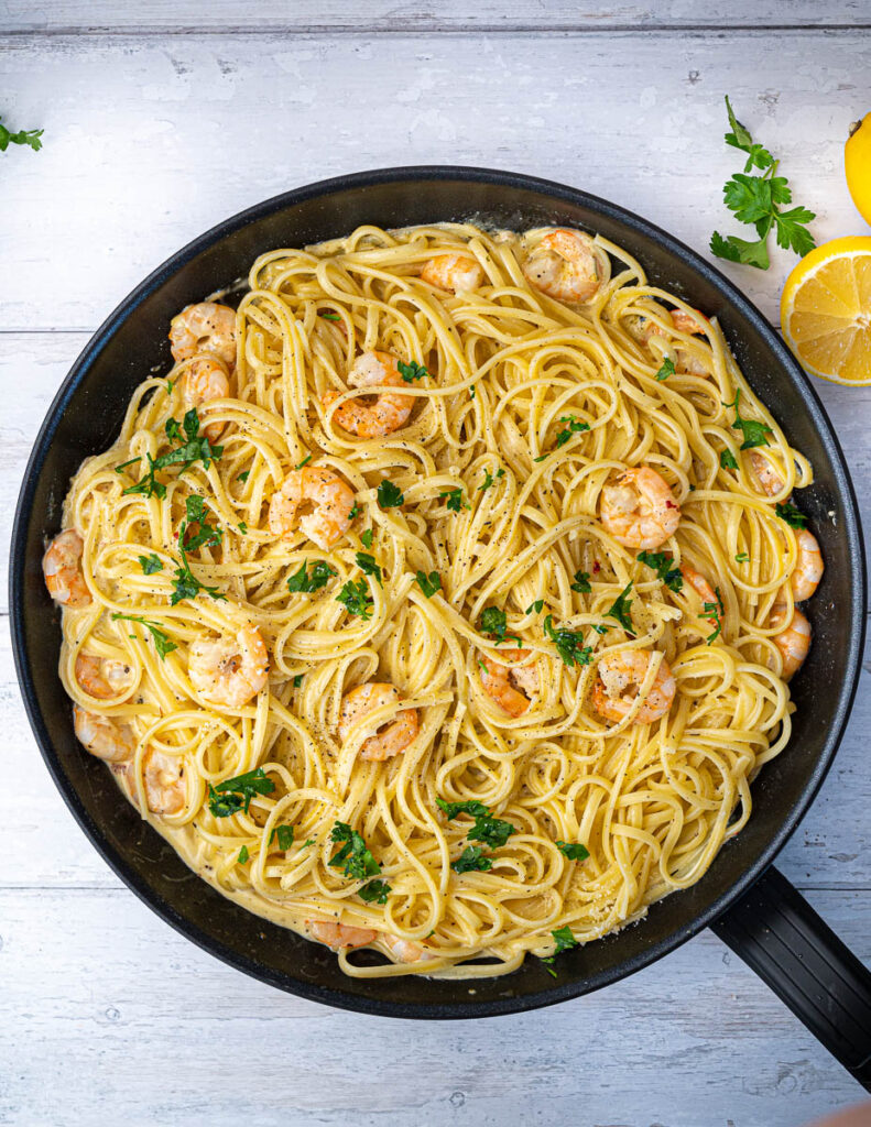 Creamy Prawn Linguine in pan with lemon