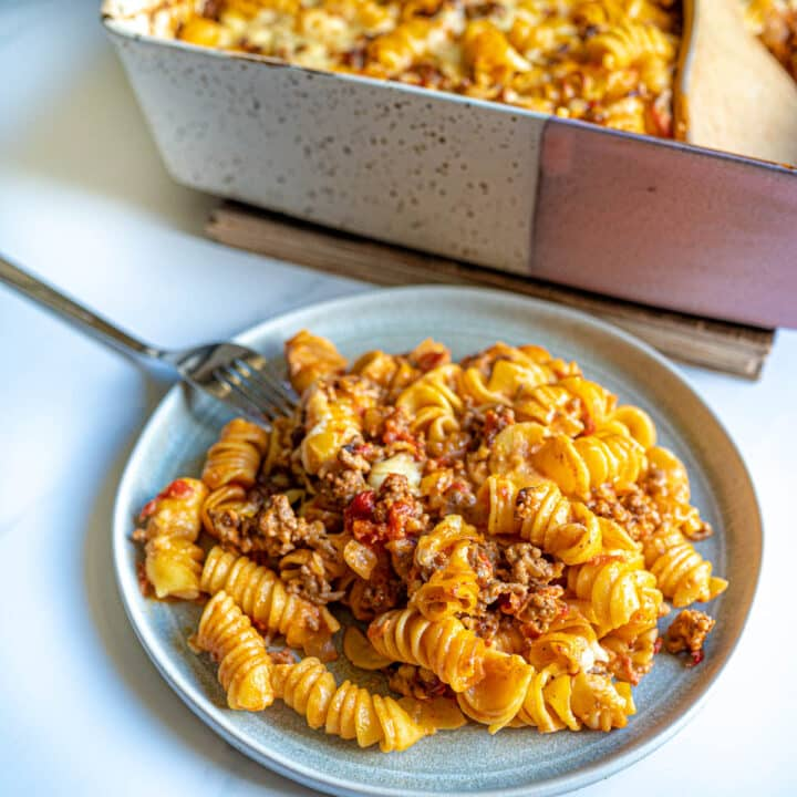 Plate with serving of pasta bake and fork