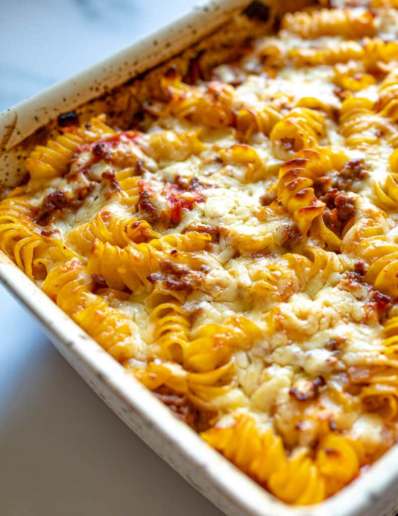 Close up of Bolognese pasta bake in oven dish