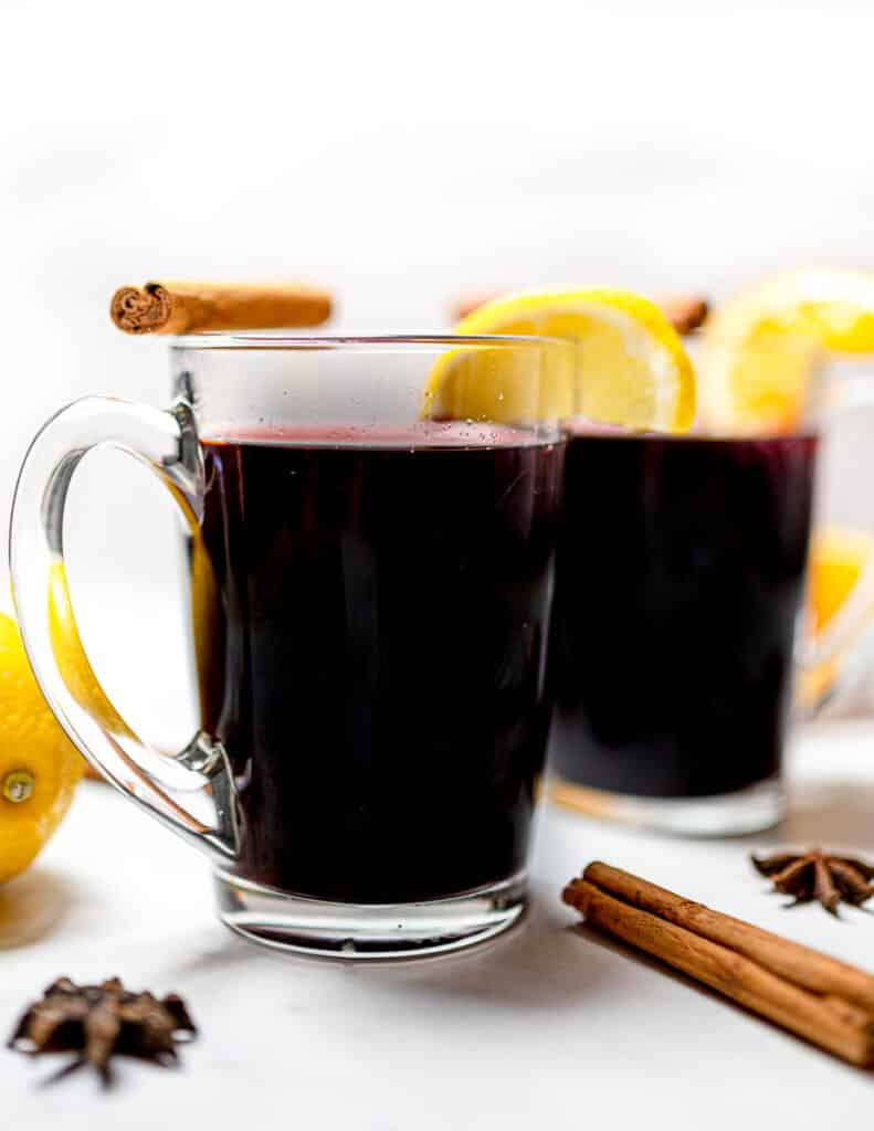 chai mulled wine in glasses with lemon and cinnamon
