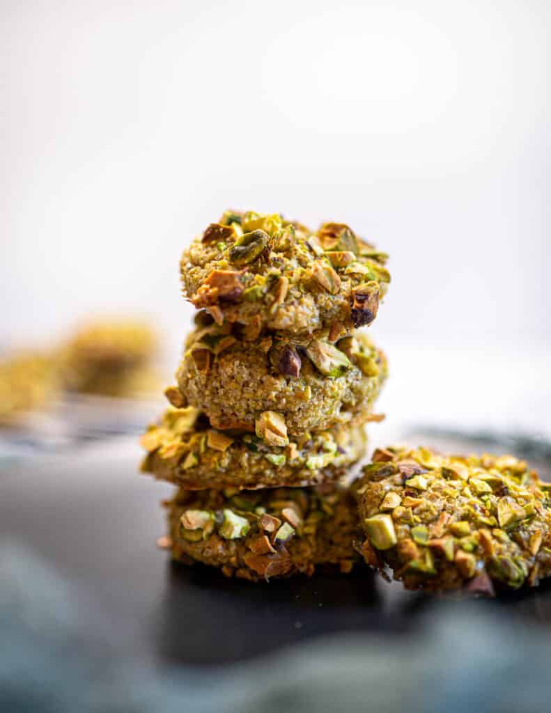 A photo of pistachio cookies tower on a plate
