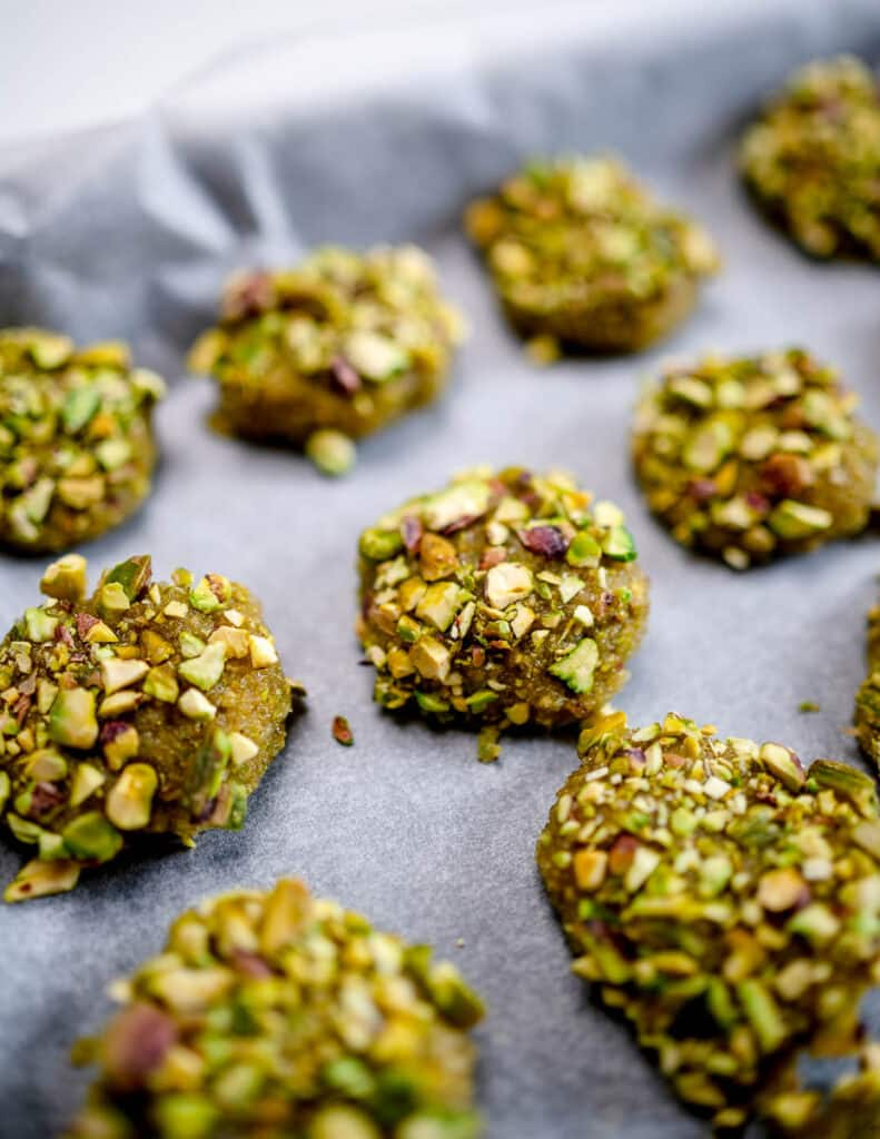 A photo of pistachio cookies on baking tray