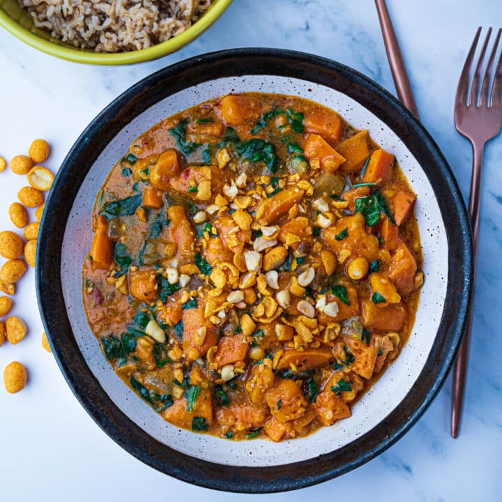 Thai red curry in bowl with peanuts on top