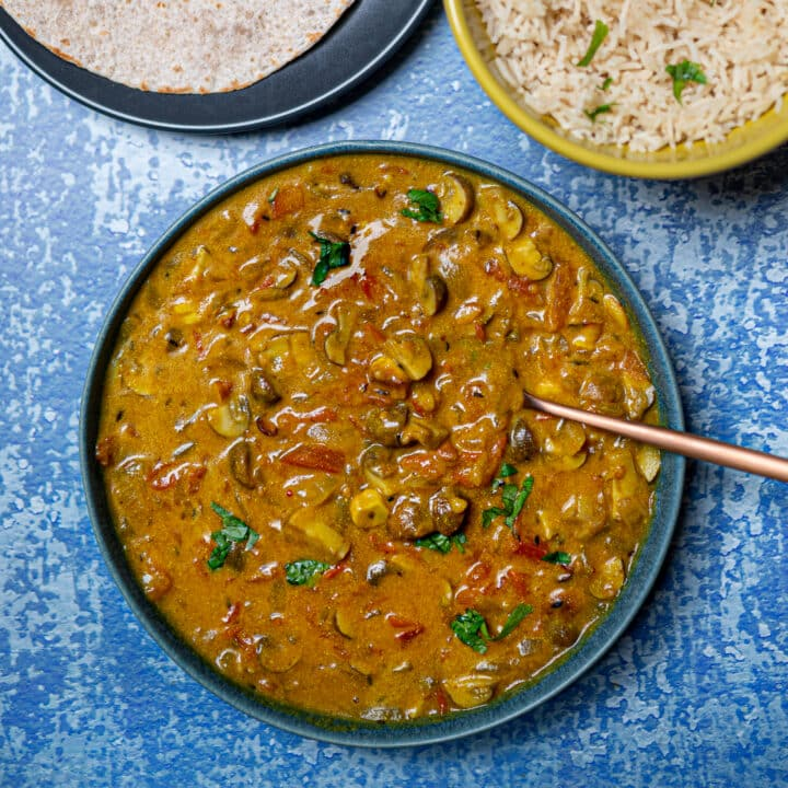 Photo of mushroom curry bowl with spoon in