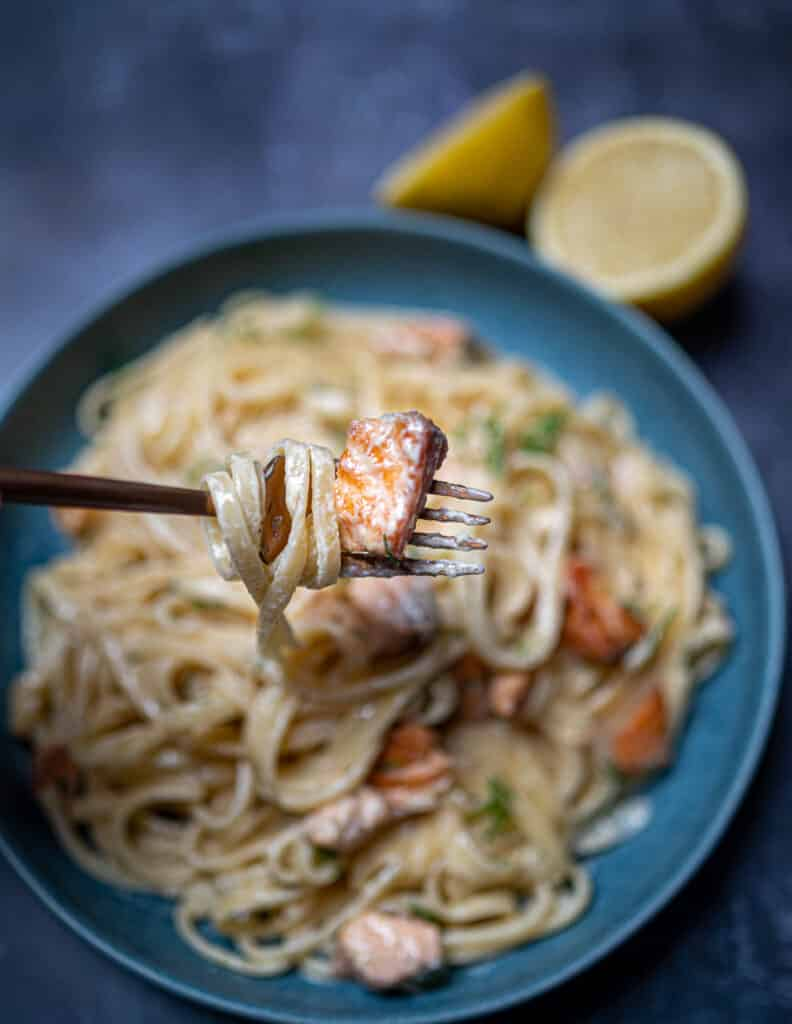 Close up of lemon dill salmon pasta in fork