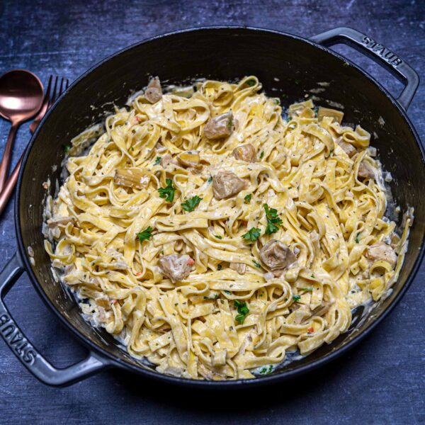 Photo of a grey casserole with Boursin pasta with artichokes