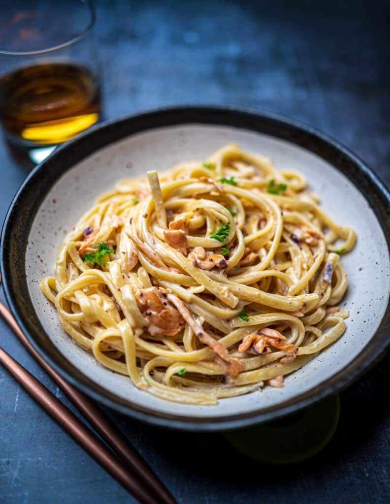 Bowl of smoked salmon pasta with whisky and mustard sauce