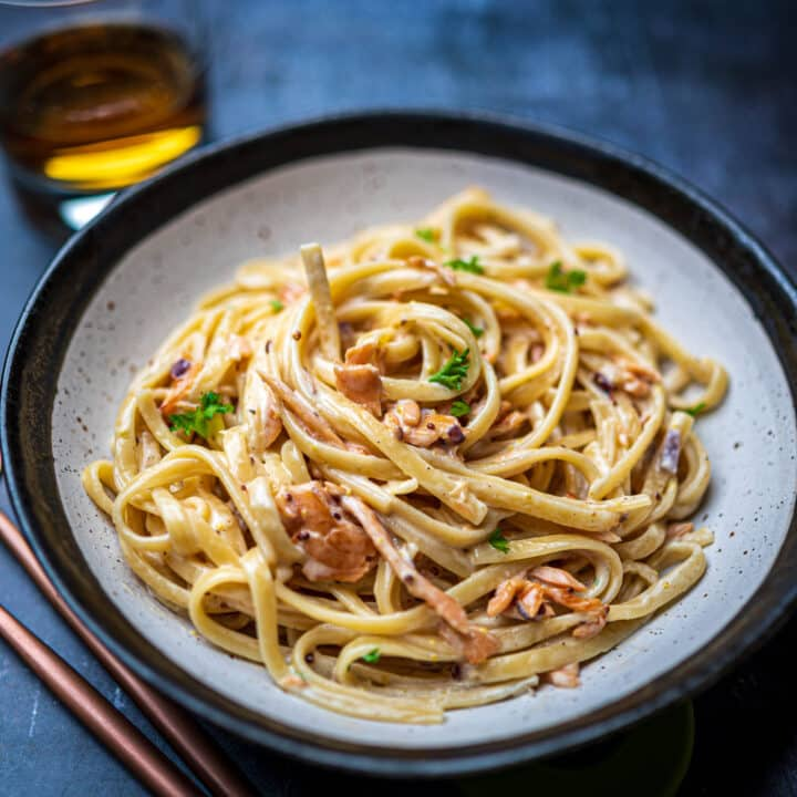 Close up photo of a bowl of pasta with smoked salmon and whisky sauce