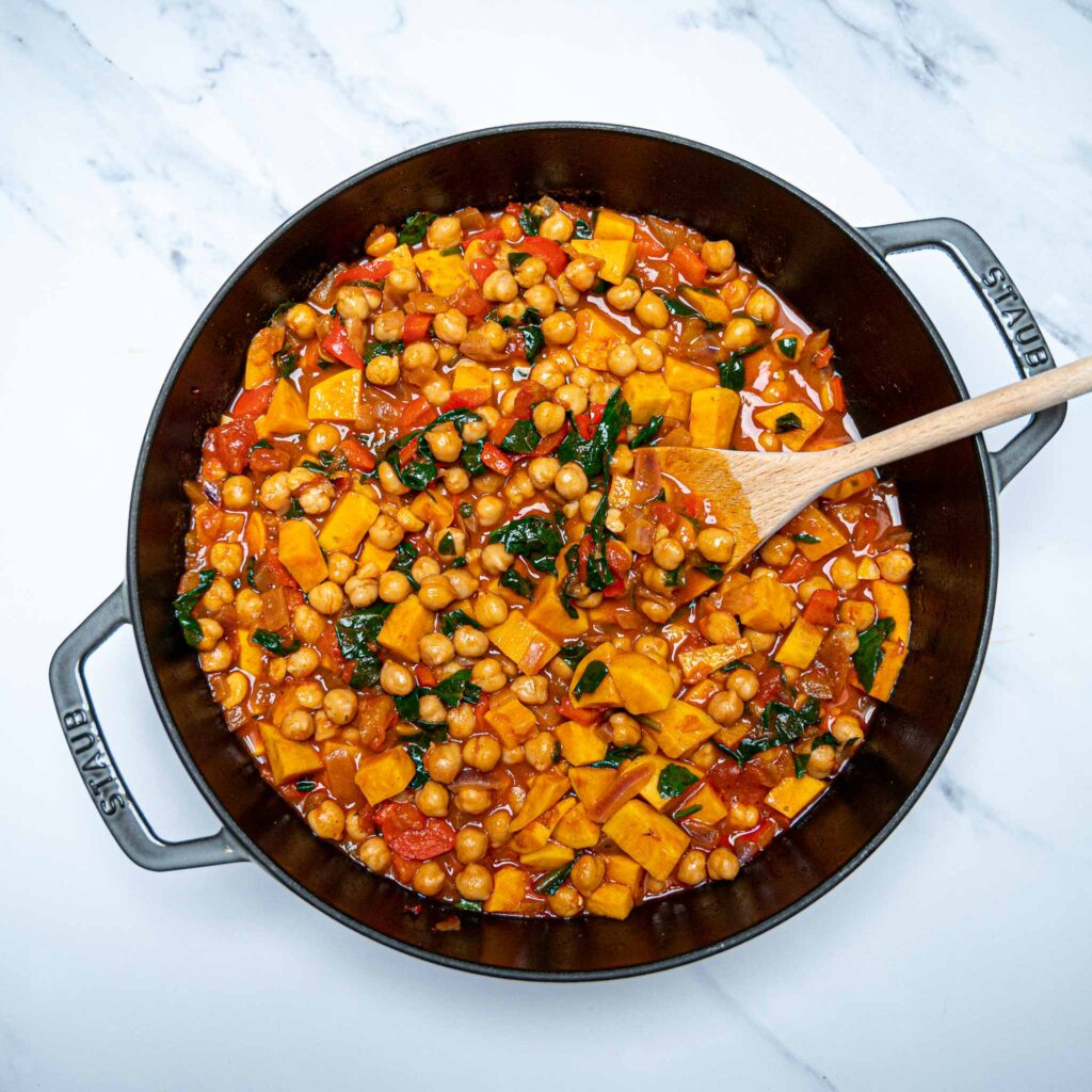 Photo of a large grey pan with chickpea and sweet potato stew