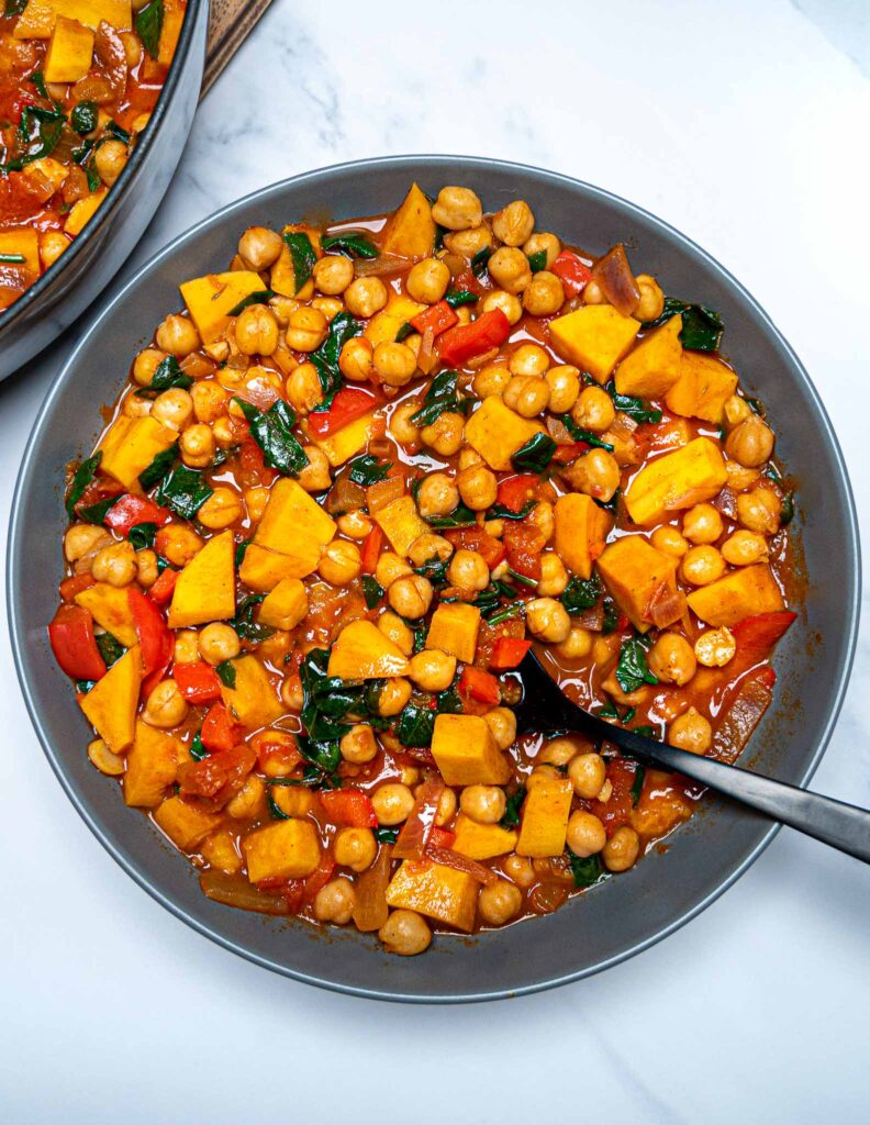 A photo of a grey bowl full of chickpea stew