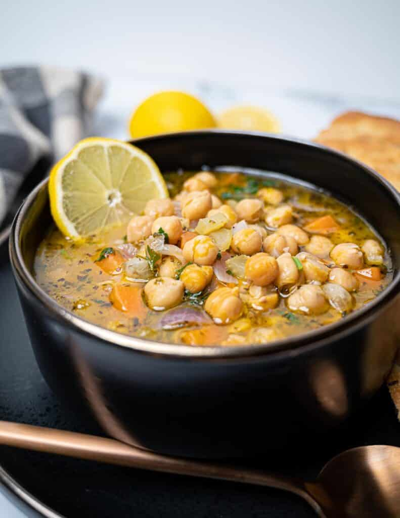 Close up photo of a bowl of vegan chickpea soup