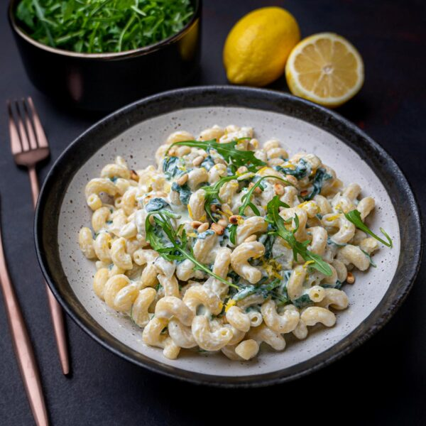 A bowl of ricotta pasta with spinach