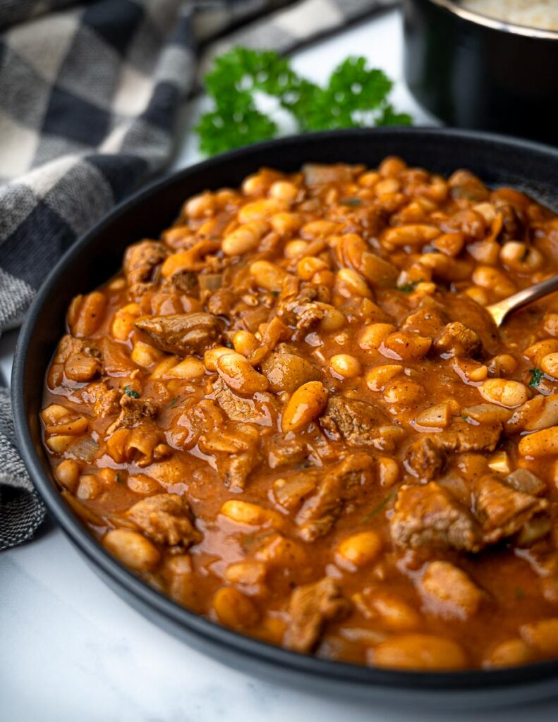A bowl of Lebanese stew with beans and lamb
