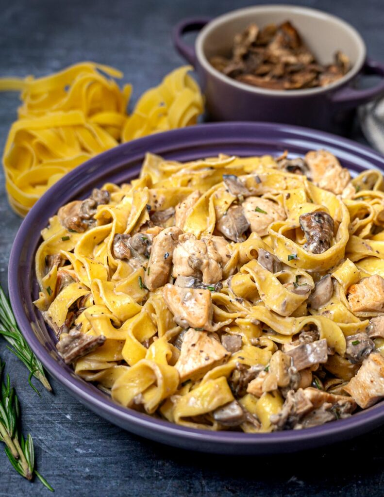 A bowl of chicken and mushroom tagliatelle
