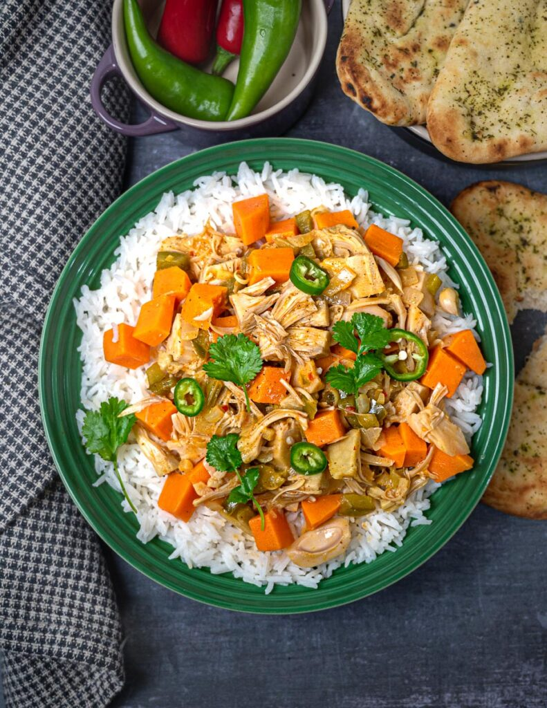 A photo of a bowl of vegan rendang curry