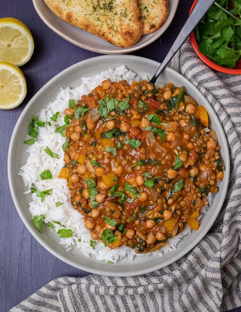 A photo of a bowl of chickpea curry with rice