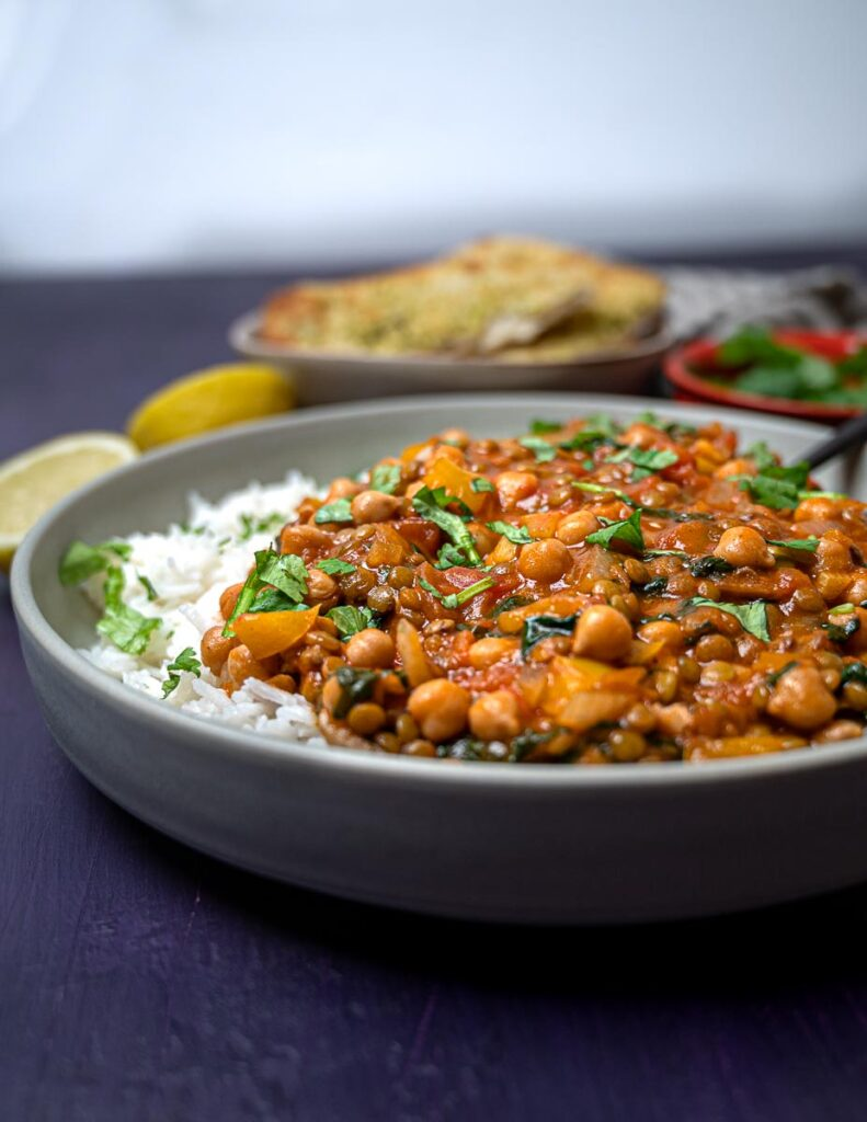 A photo of a bowl of vegan curry with chickpeas