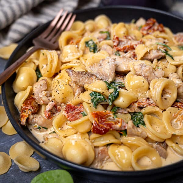 Photo of a bowl of chicken tuscan pasta