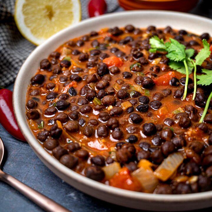 A photo of a bowl of black chana masala