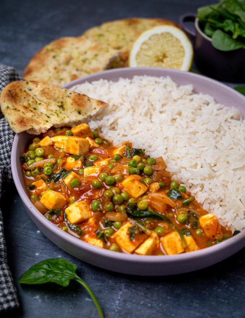 Photo of a bowl of paneer curry with basmati rice
