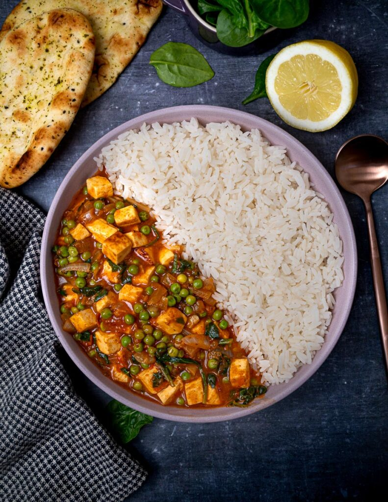 A photo of a bowl of vegetarian curry with rice