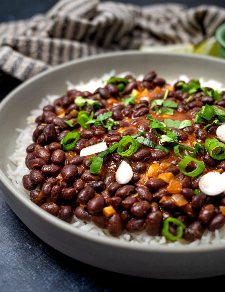 A bowl of black bean curry over basmati rice