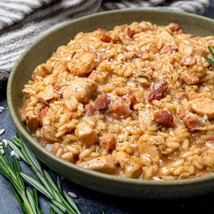 a plate of bacon and chicken risotto