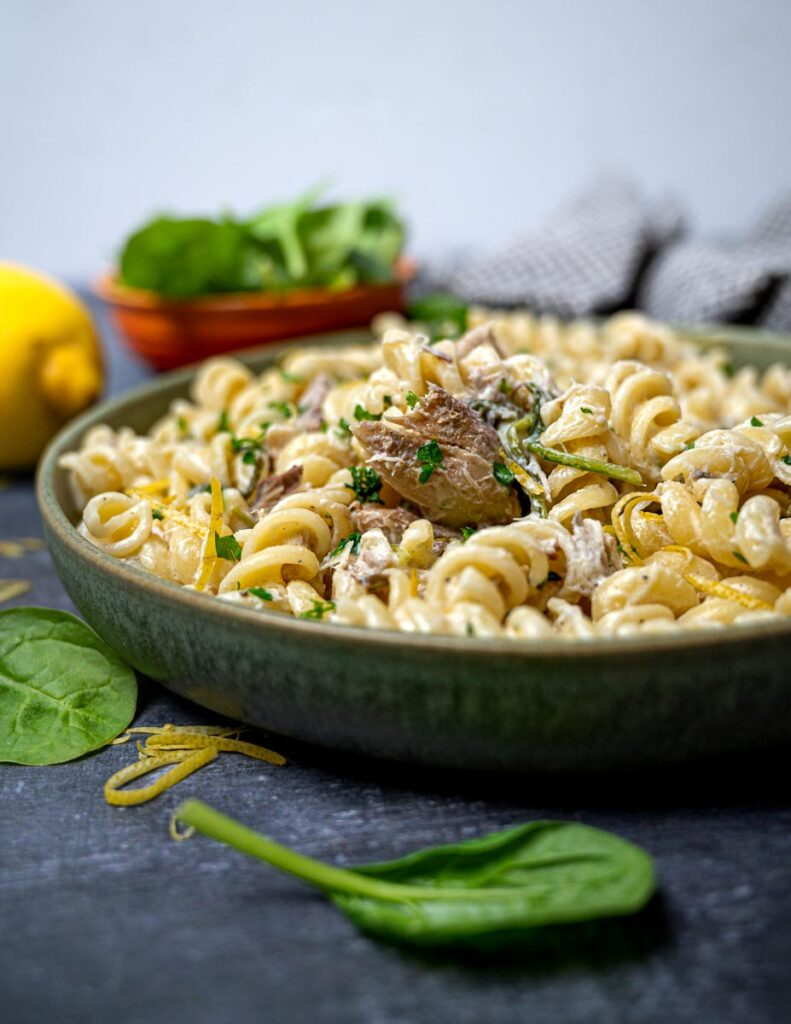 A bowl of pasta with smoked fish