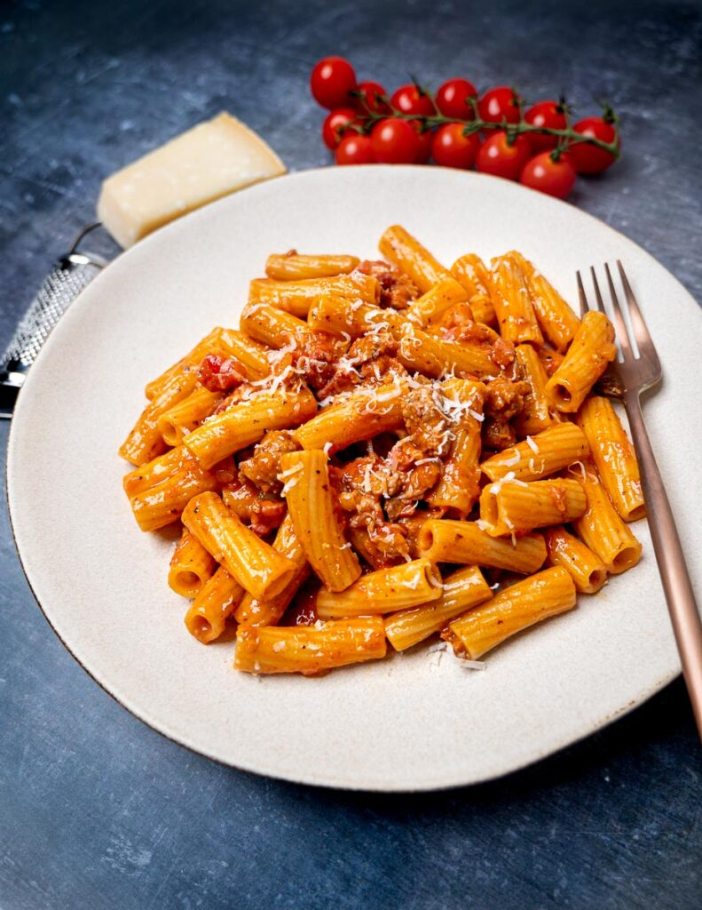 A plate of pasta alla zozzona with a fork on the side