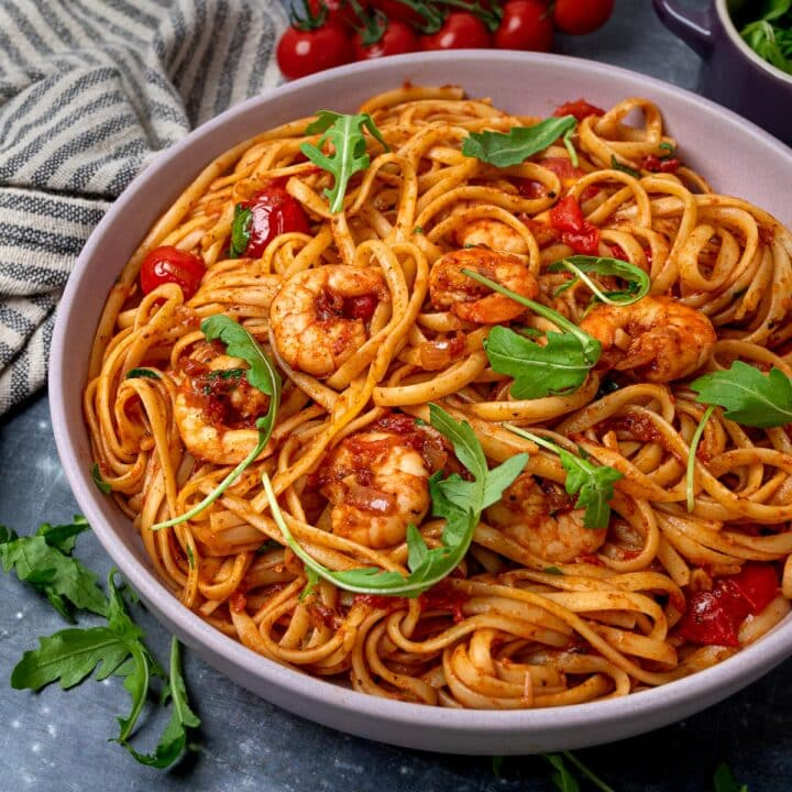A bowl of spicy prawn pasta with rocket
