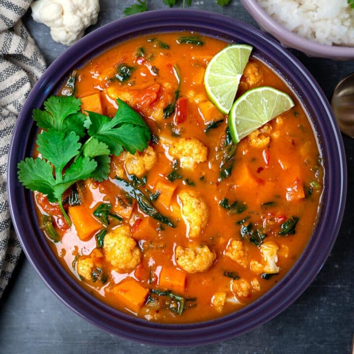 A bowl of Thai red curry with cauliflower and sweet potatoes