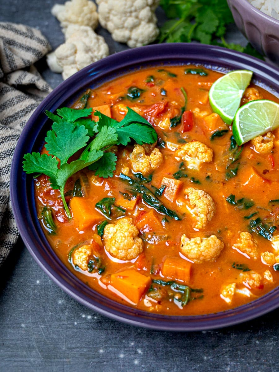 A bowl of vegan curry with cauliflower and sweet potatoes