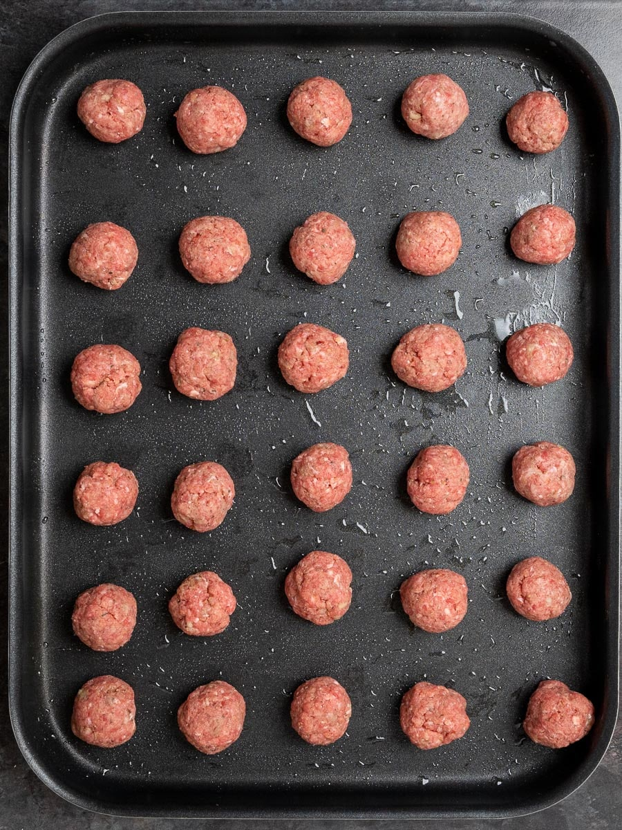Meatballs on a tray ready to go in the oven