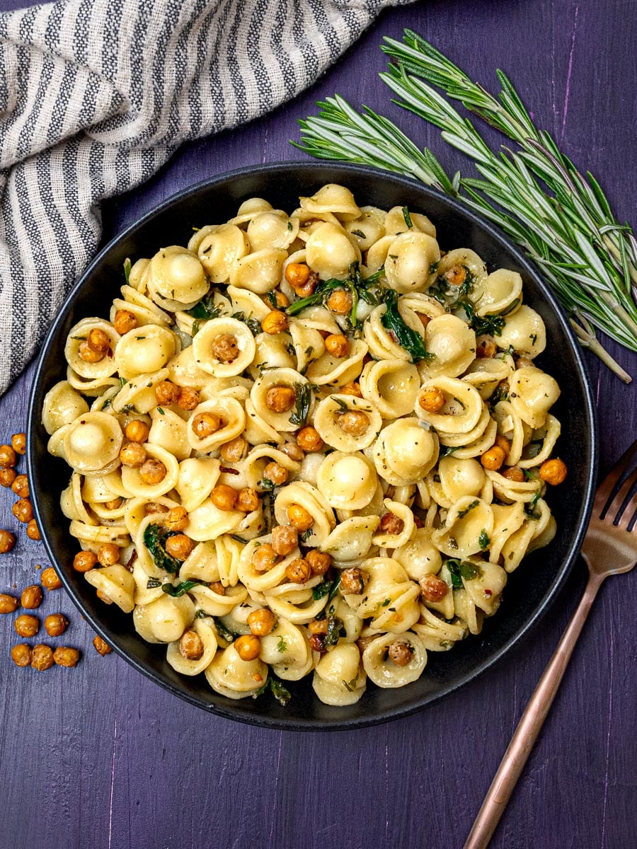 A bowl of pasta with roasted chickpeas and rosemary