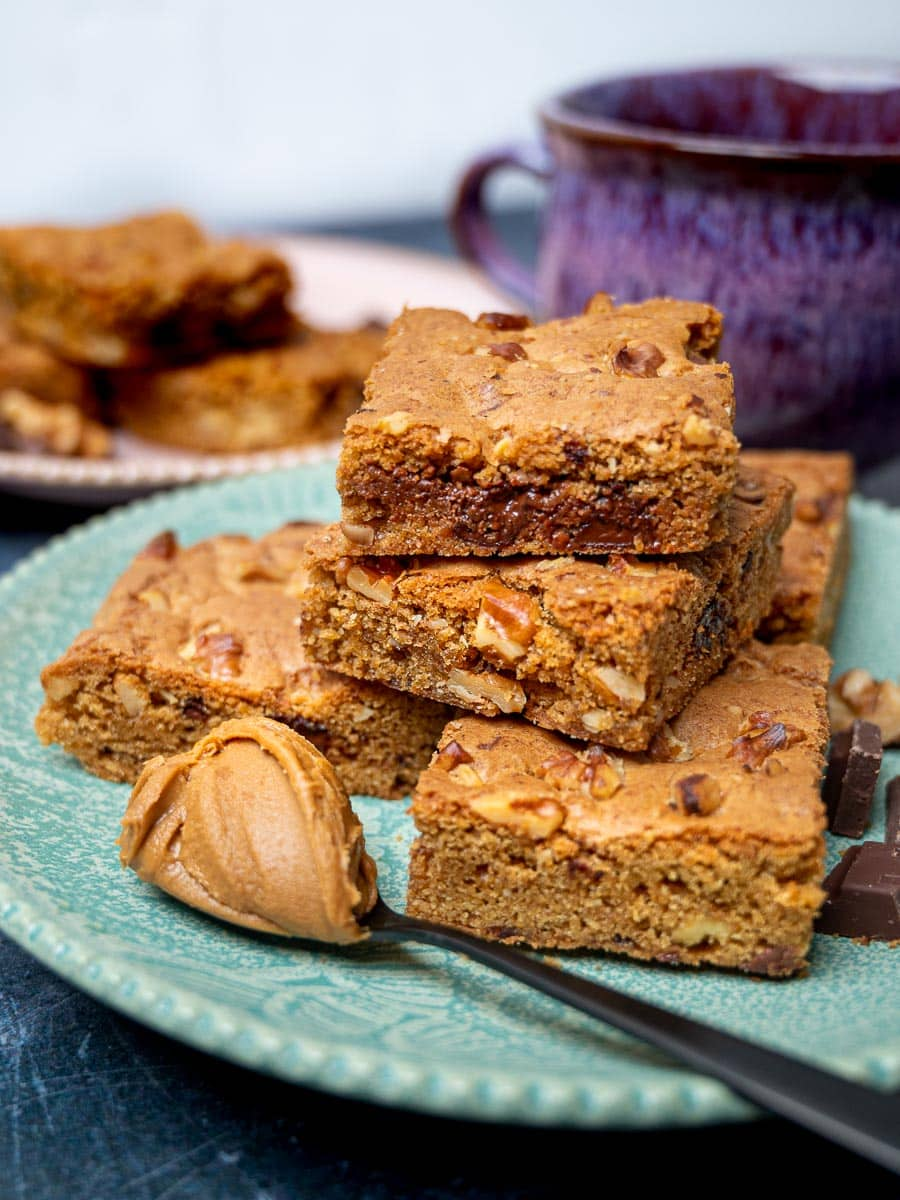 A plate of blondies with a spoon of Biscoff spread