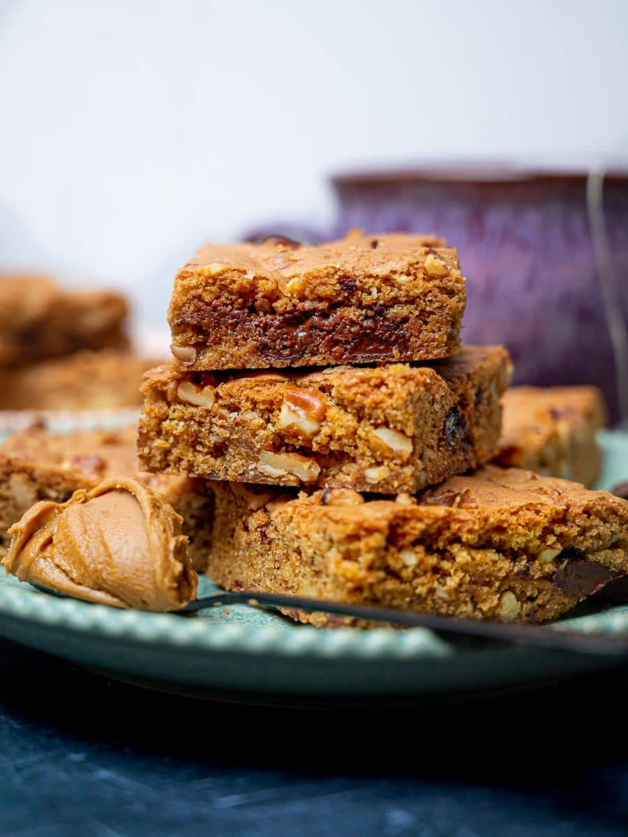 Biscoff blondies stacked on a plate
