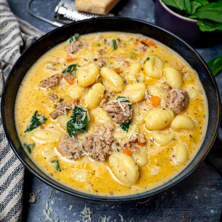 A bowl of creamy gnocchi soup with sausage